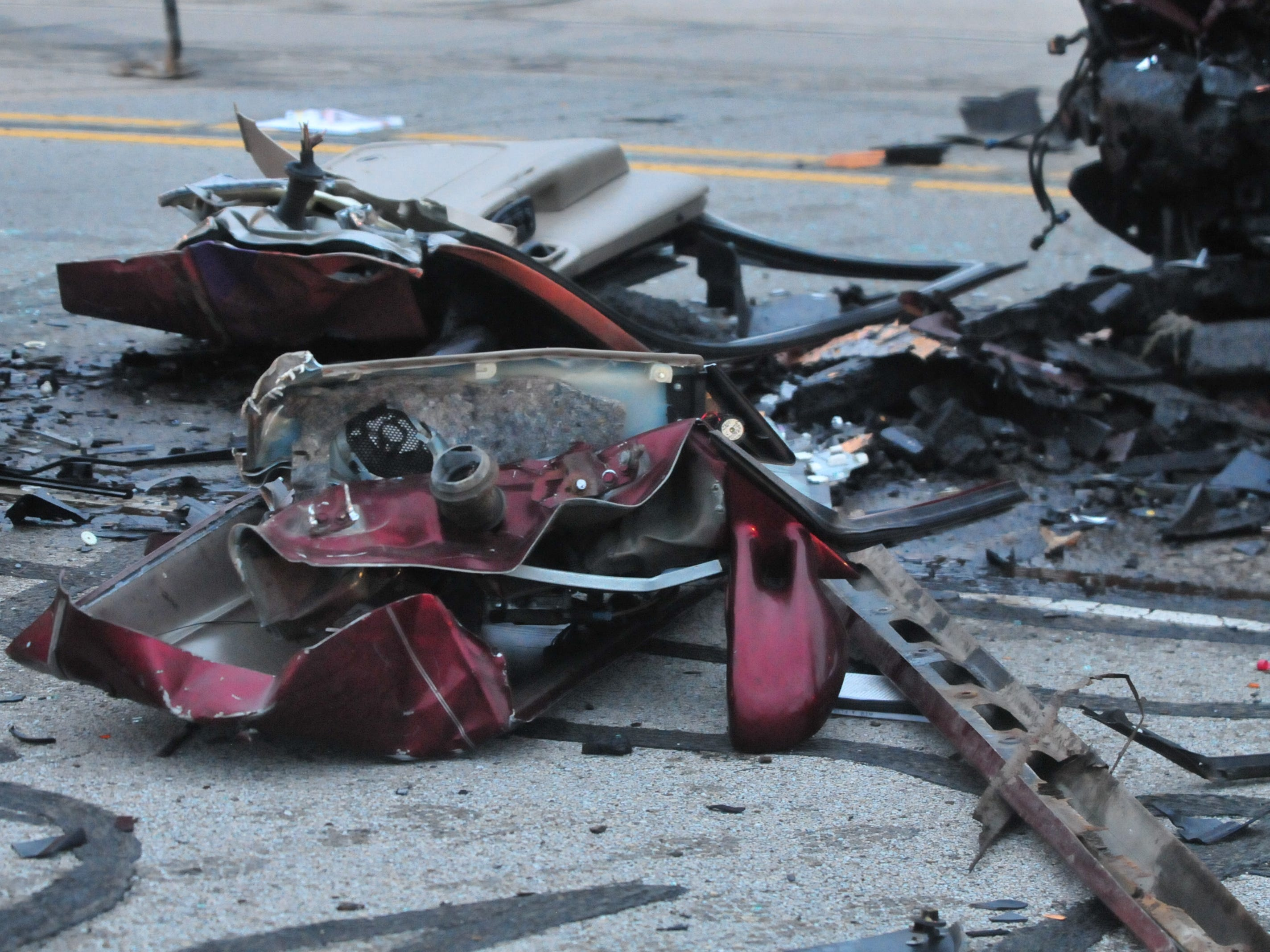 Debris sits between two vehicles involved in a head-on collision Tuesday on Salisbury Road.