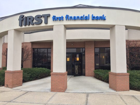 Richmond Police Department Detective Tom Legear exits the First Financial Bank branch Wednesday during an active investigation at the bank.