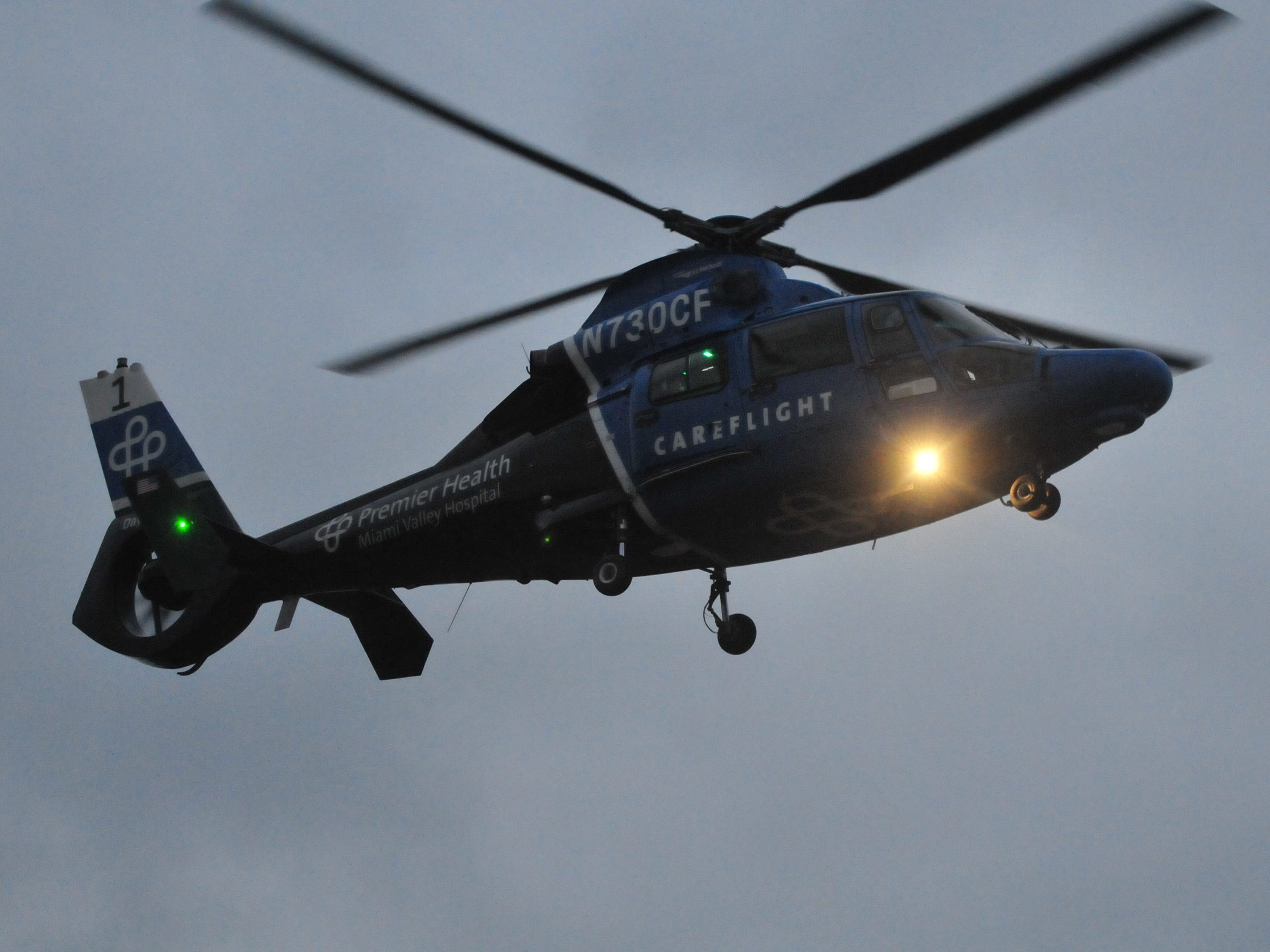 A Careflight medical helicopter descends for a landing Tuesday west of Salisbury Road.