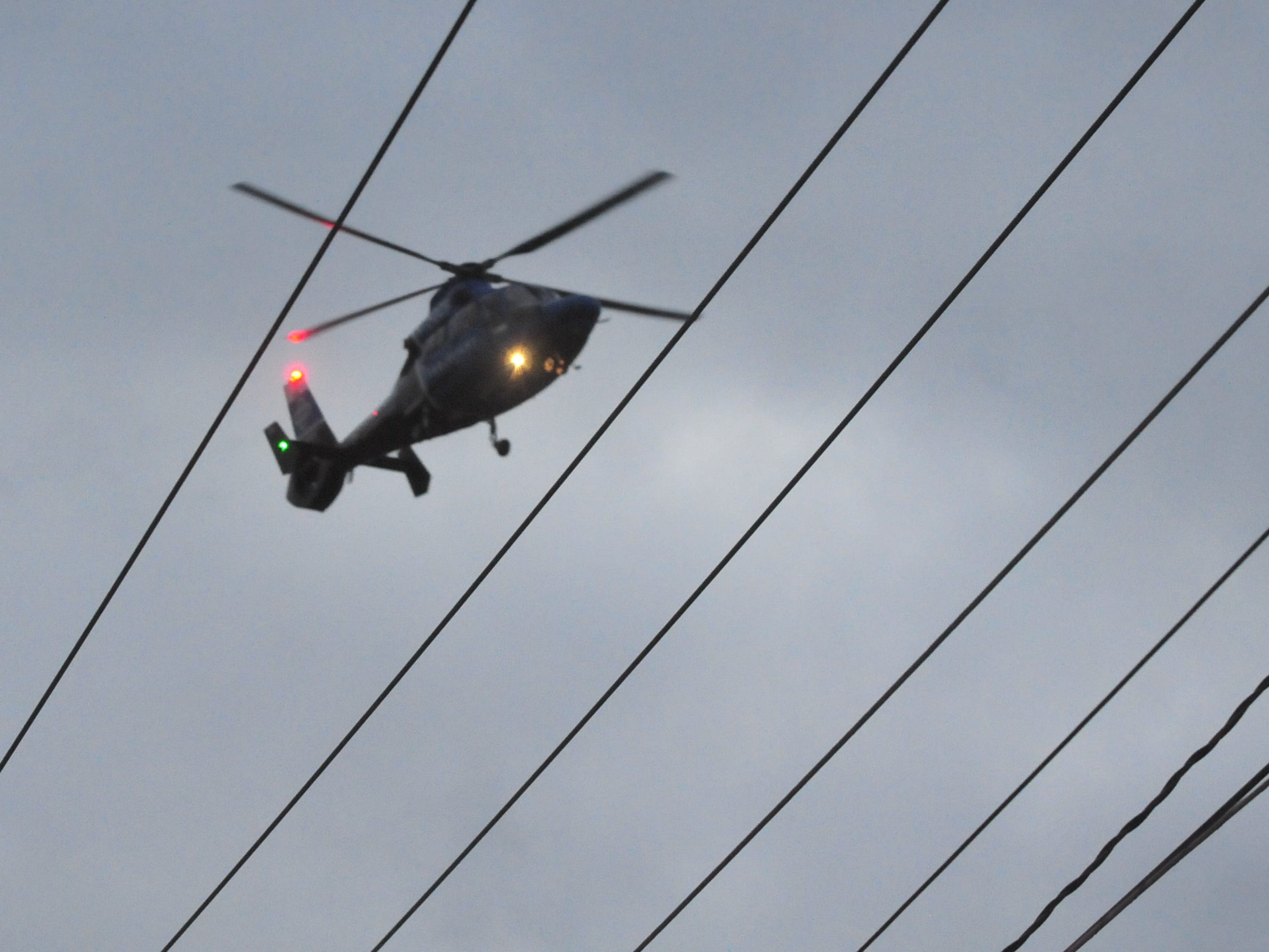 A Careflight medical helicopter descends for a landing Tuesday at the scene of a head-on collision on Salisbury Road.