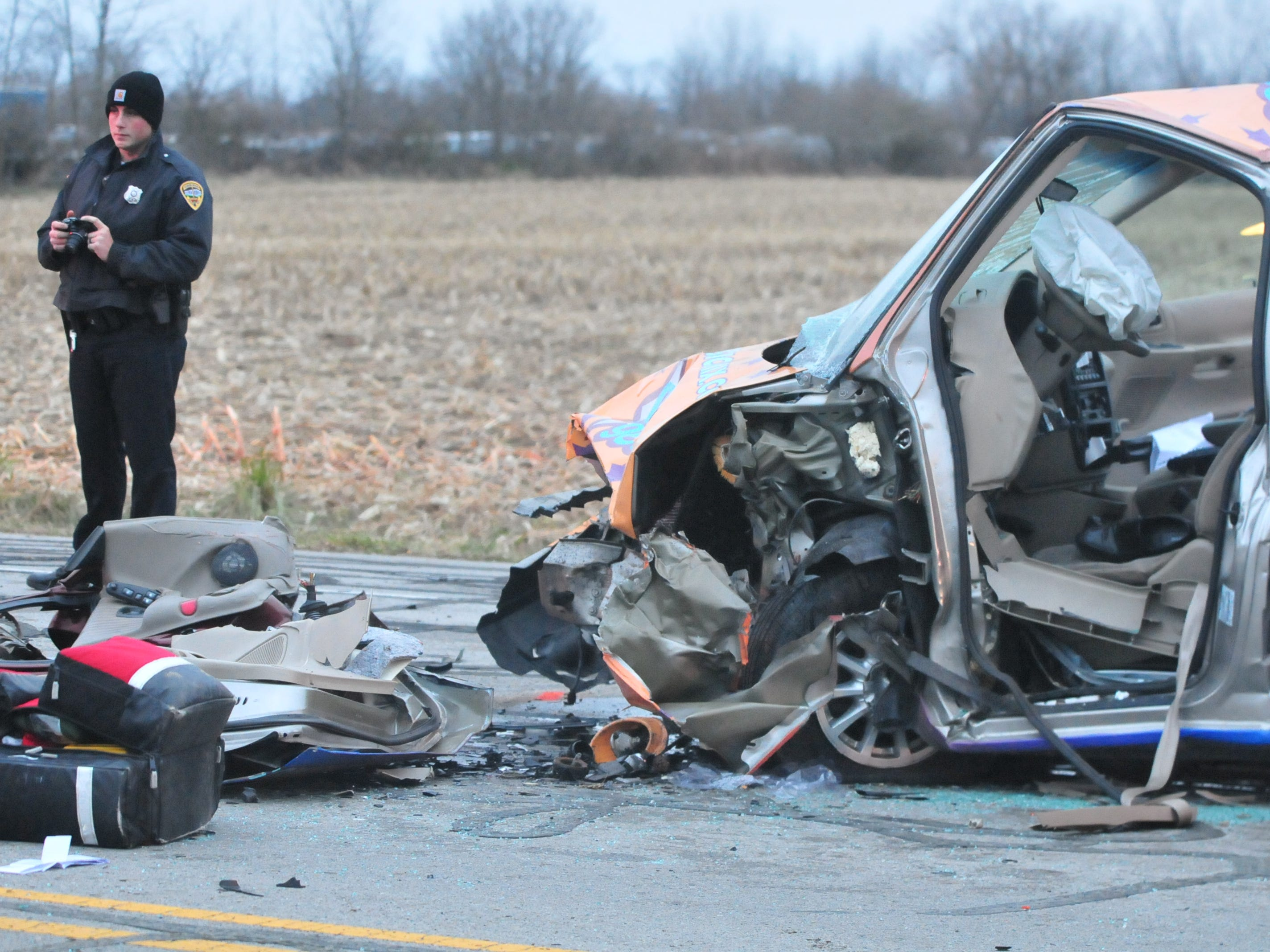 A Ford van sits damaged after a head-on collision with a Pontiac Grand Prix on Salisbury Road just north of Rich Road.