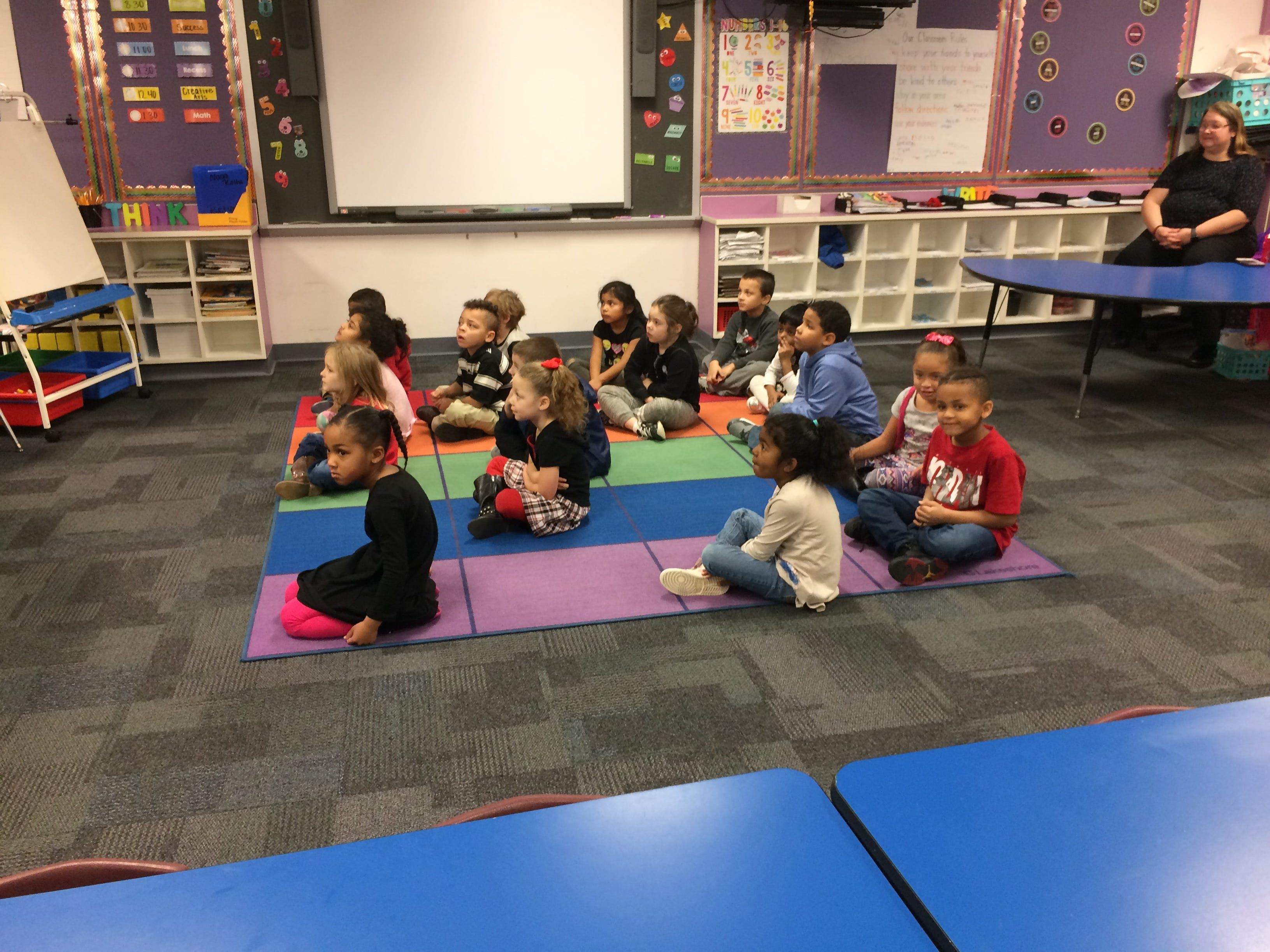 Vaile Elementary kindergartners listen Tuesday as they are honored by Richmond Police Department for their response to finding what turned out to be a toy gun on the playground.