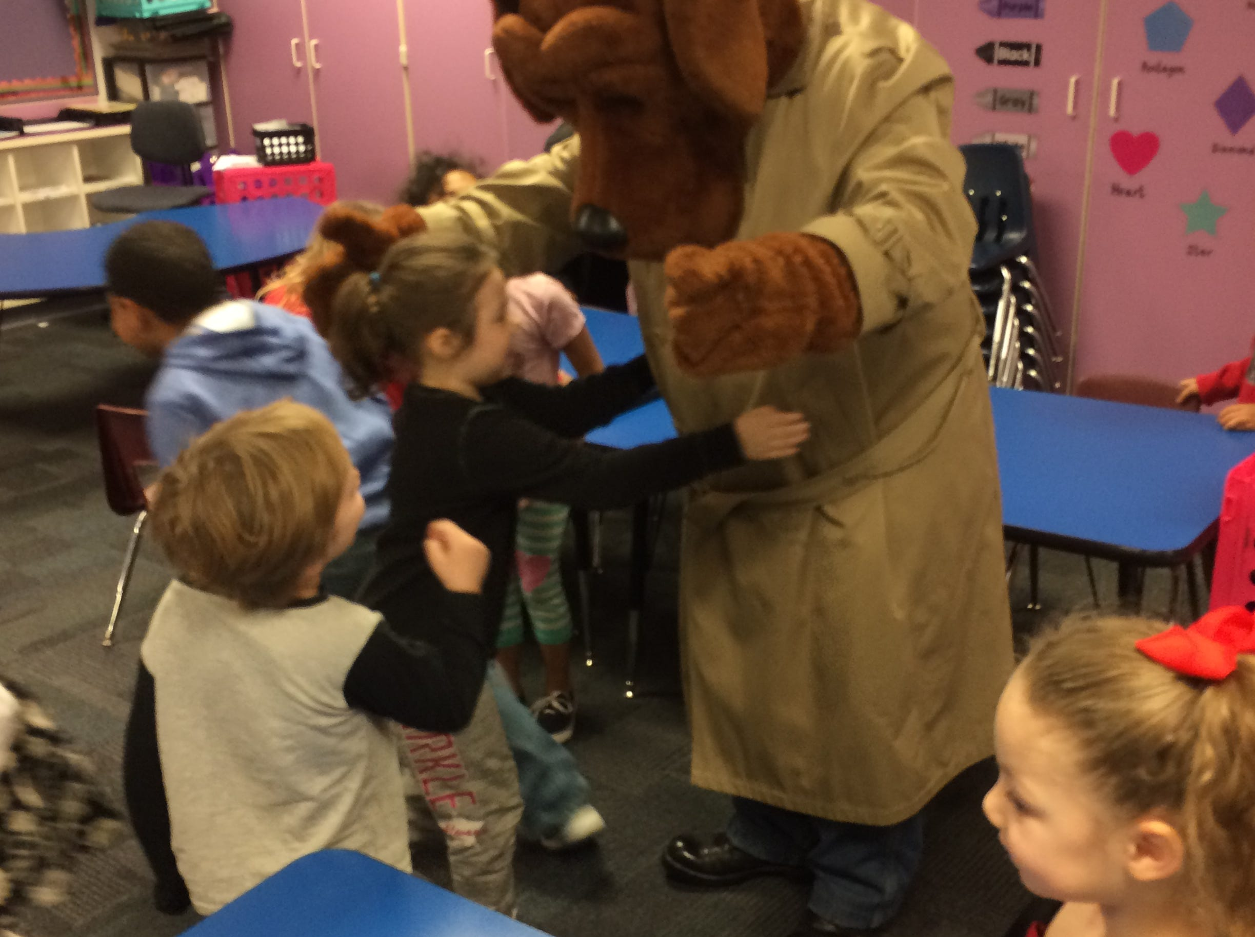 Kindergartners swarm McGruff the Crime Dog after they were presented a Good Citizen Award.
