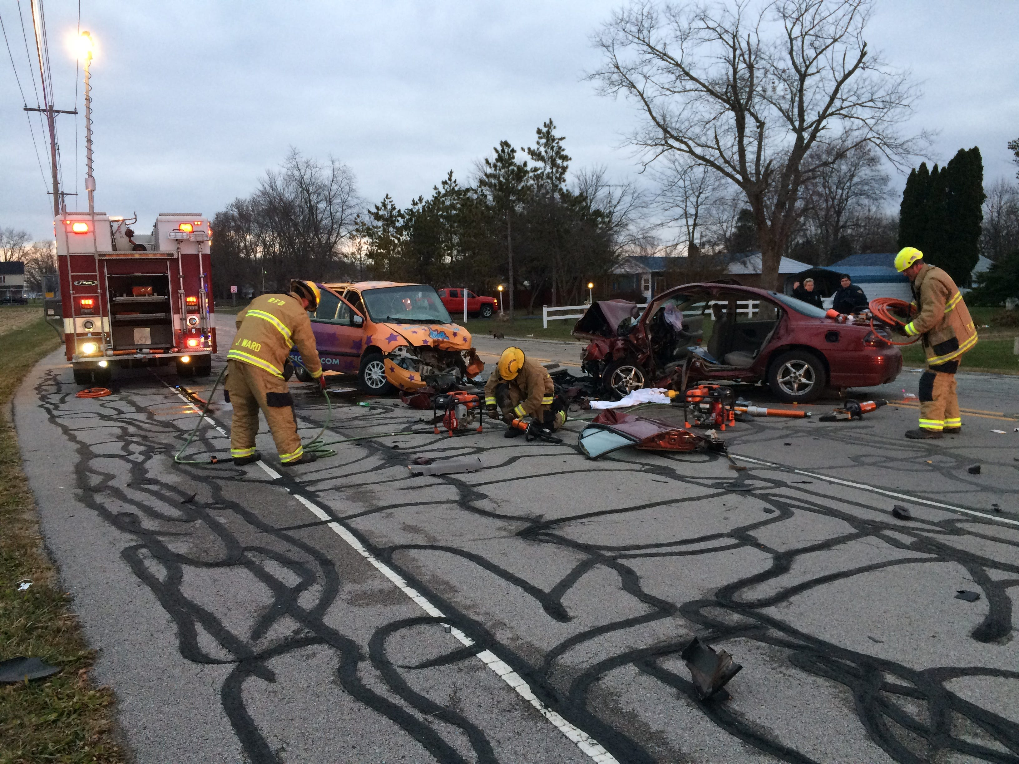 Richmond Fire Department personnel clean up their equipment after extricating a driver from a vehicle Tuesday on Salisbury Road.