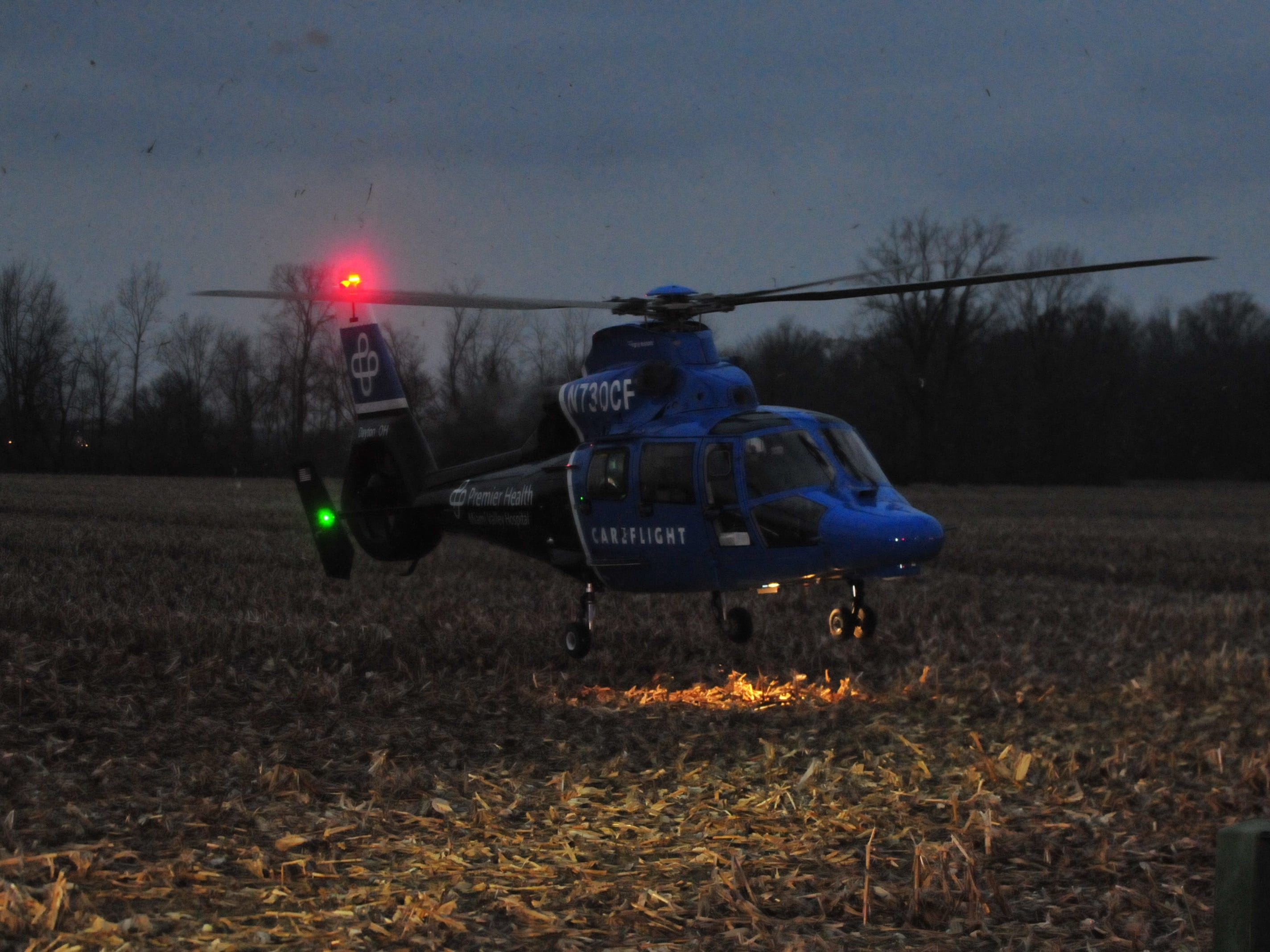 A Careflight helicopter lands Tuesday in a cornfield west of Salisbury Road.
