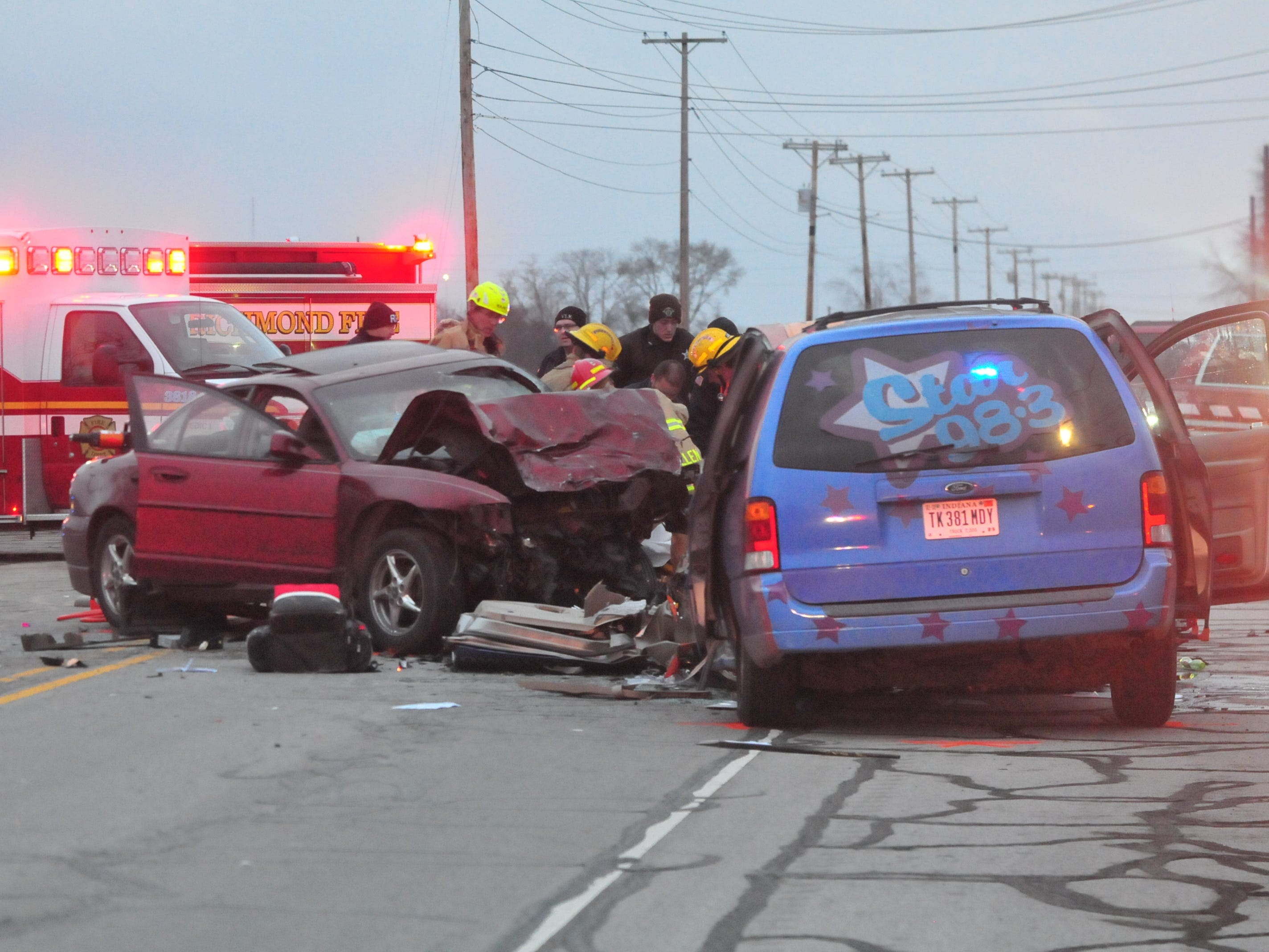 Richmond Fire Department personnel work to extricate the driver of a Pontiac Grand Prix from his car following a head-on collision with a Ford van Tuesday on Salisbury Road.