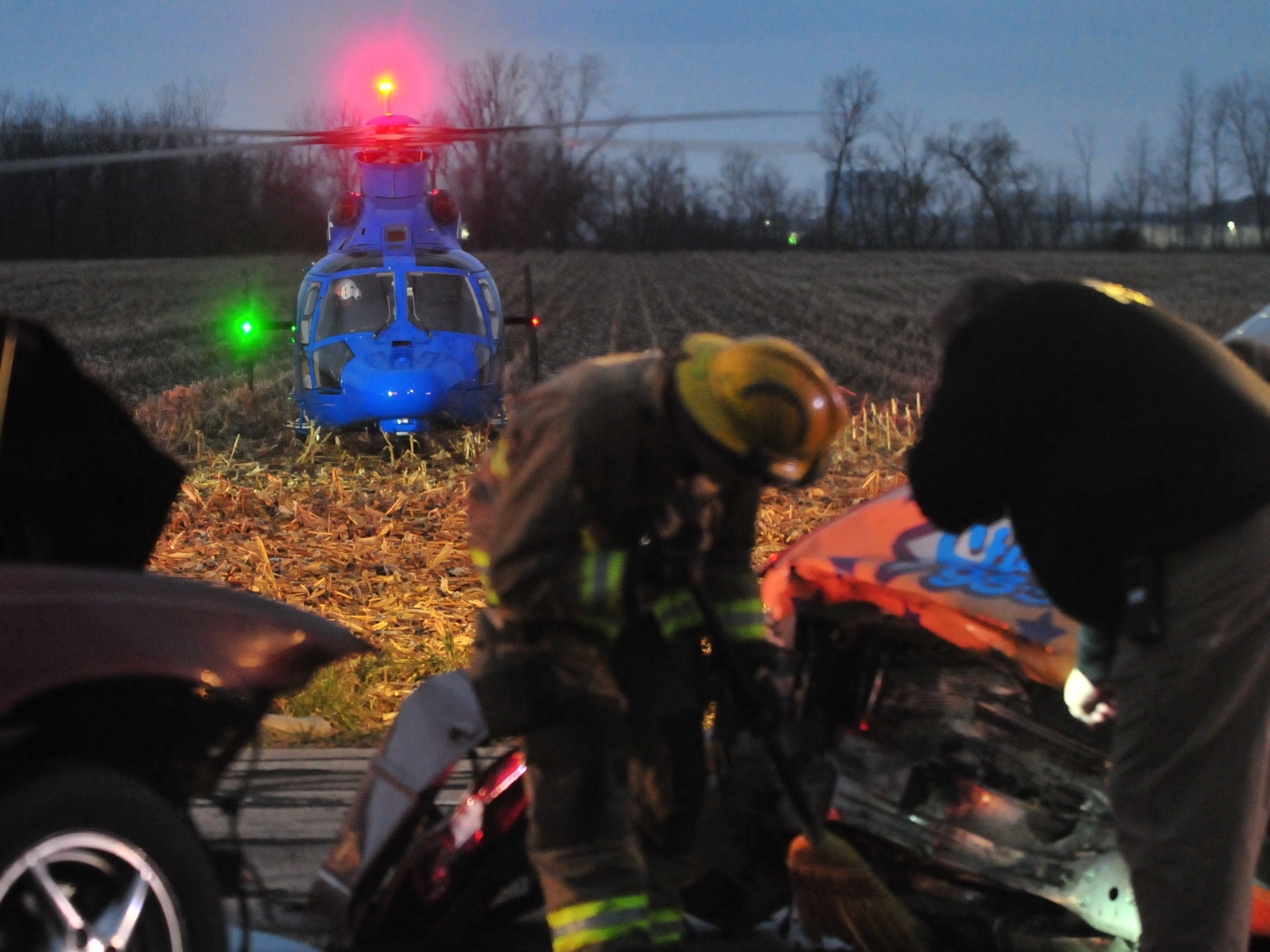 An accident scene is investigated as a Careflight helicopter waits for a patient Tuesday on Salisbury Road.