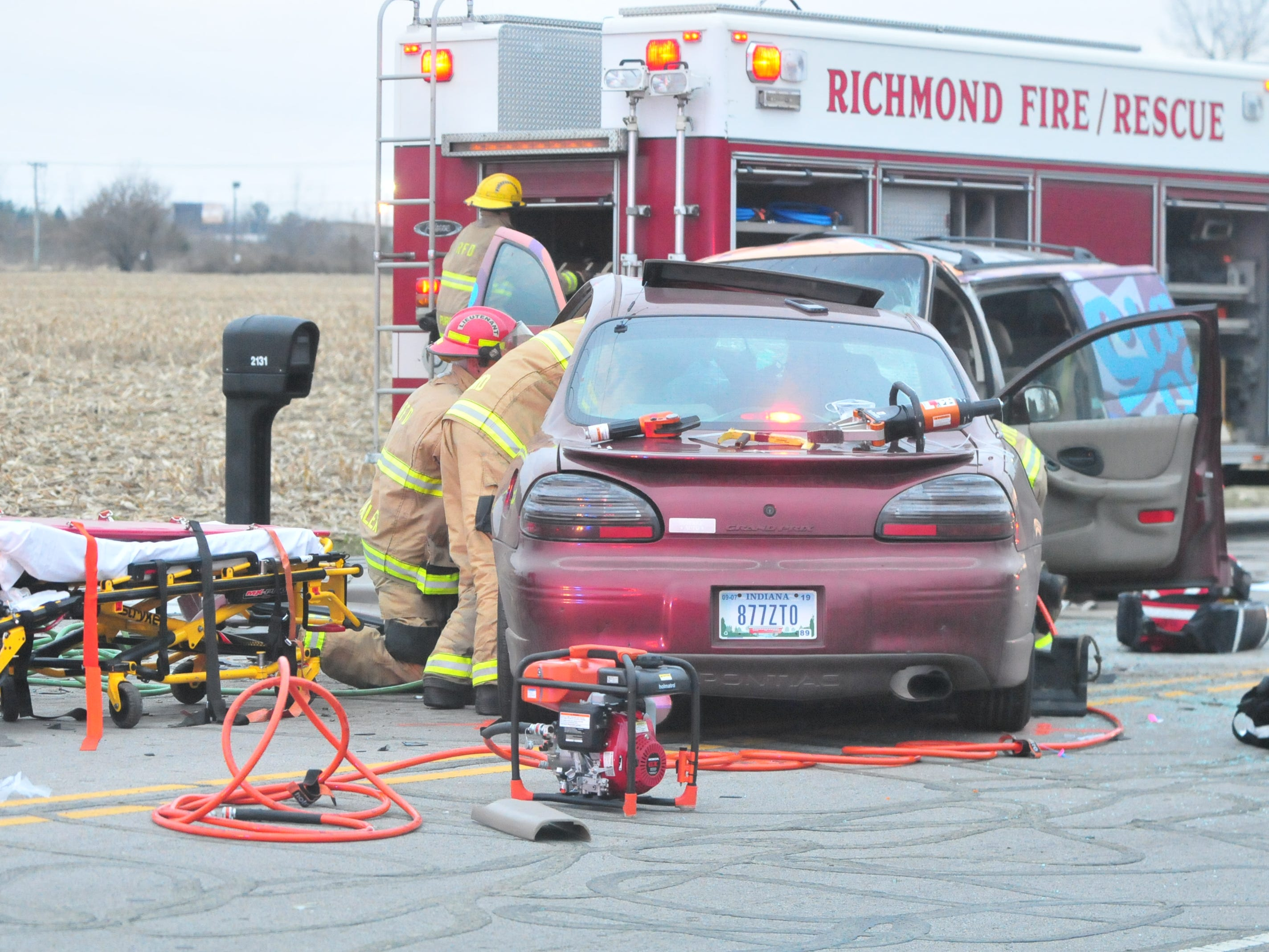 Richmond Fire Department personnel work to extricate the driver of a Pontiac Grand Prix from his car after a Tuesday accident on Salisbury Road just north of Rich Road.