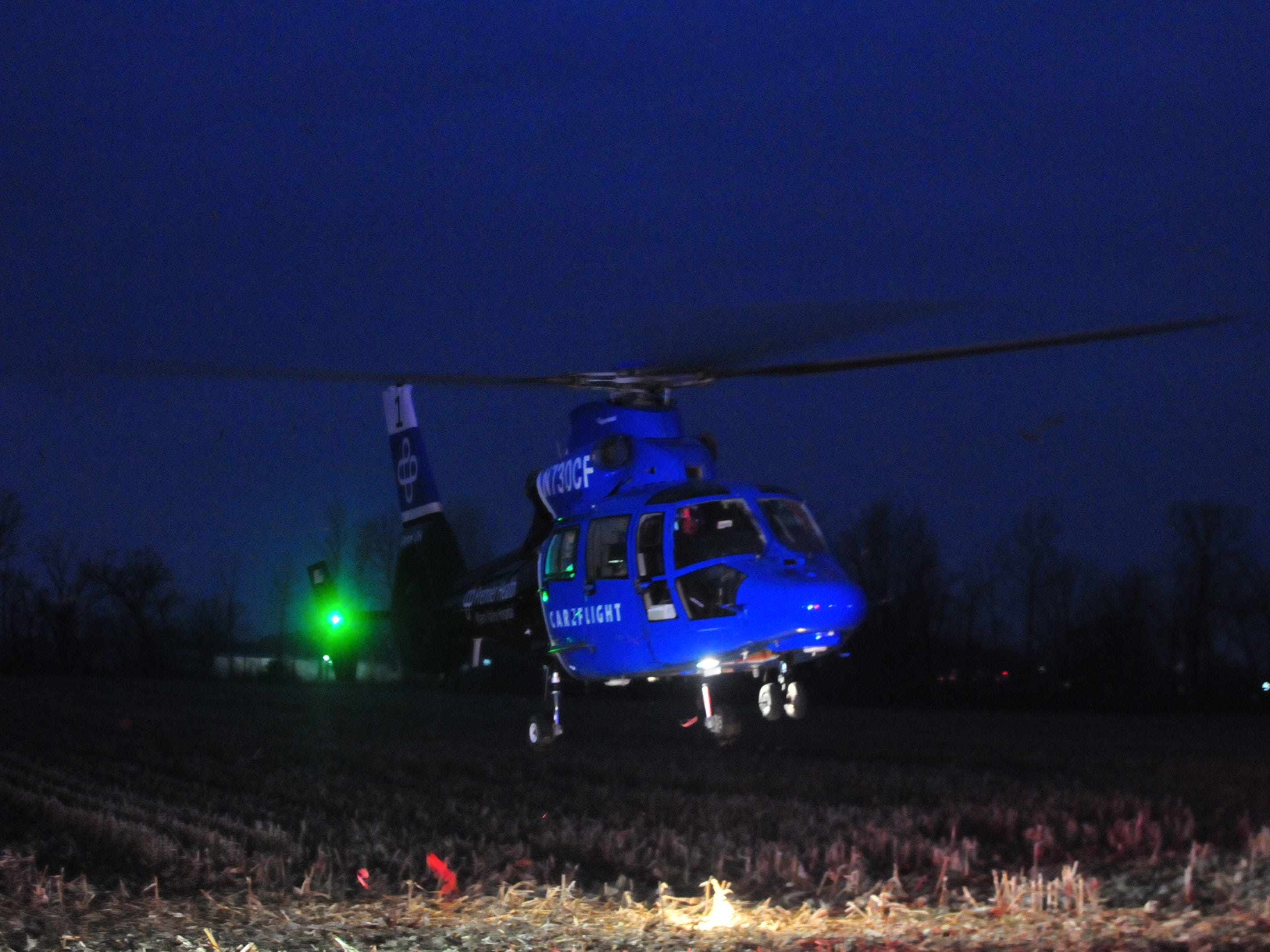A Careflight helicopter lifts off with a patient Tuesday west of Salisbury Road.