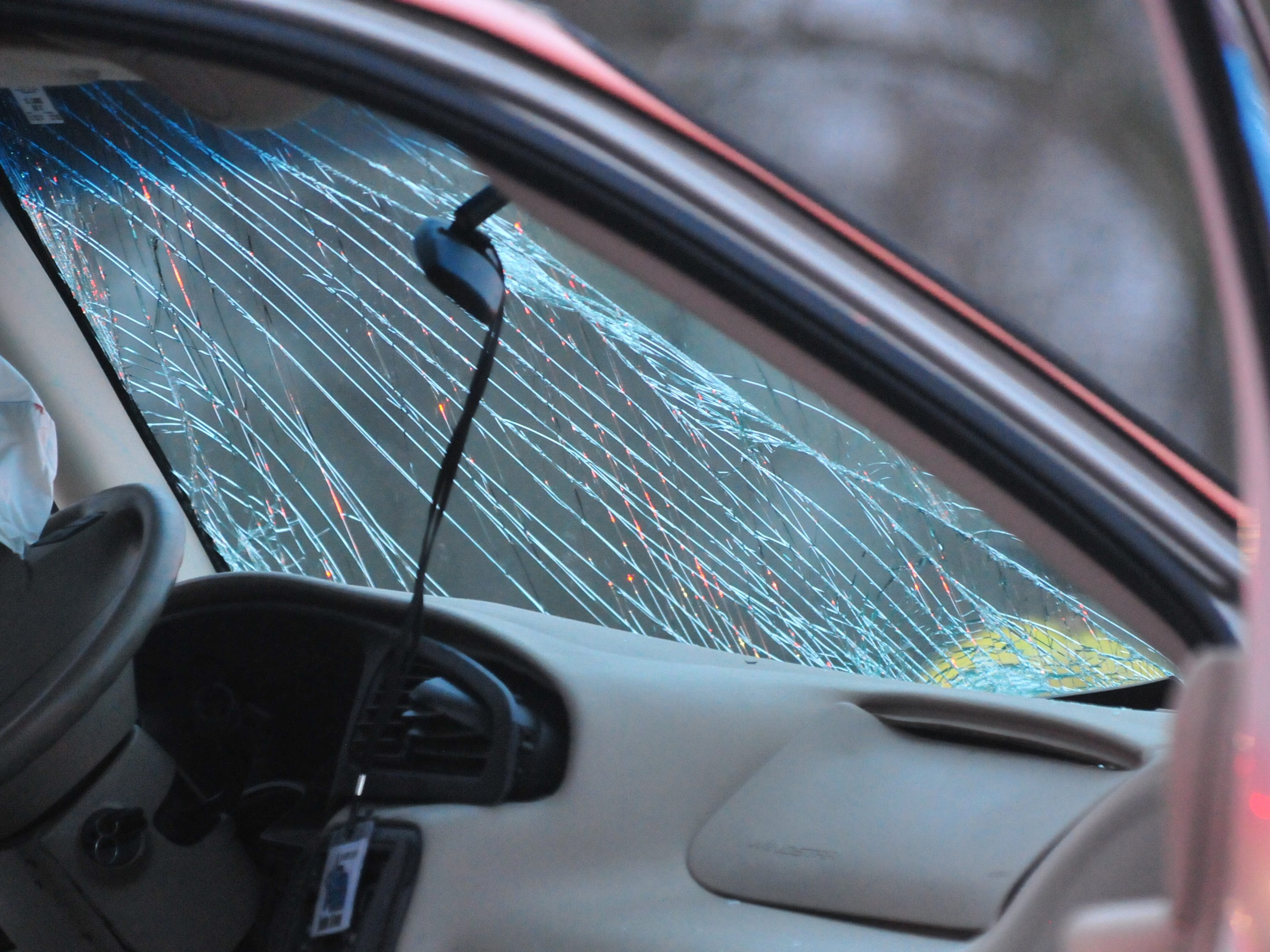The windshield of a Ford van shows damage following an accident Tuesday on Salisbury Road.