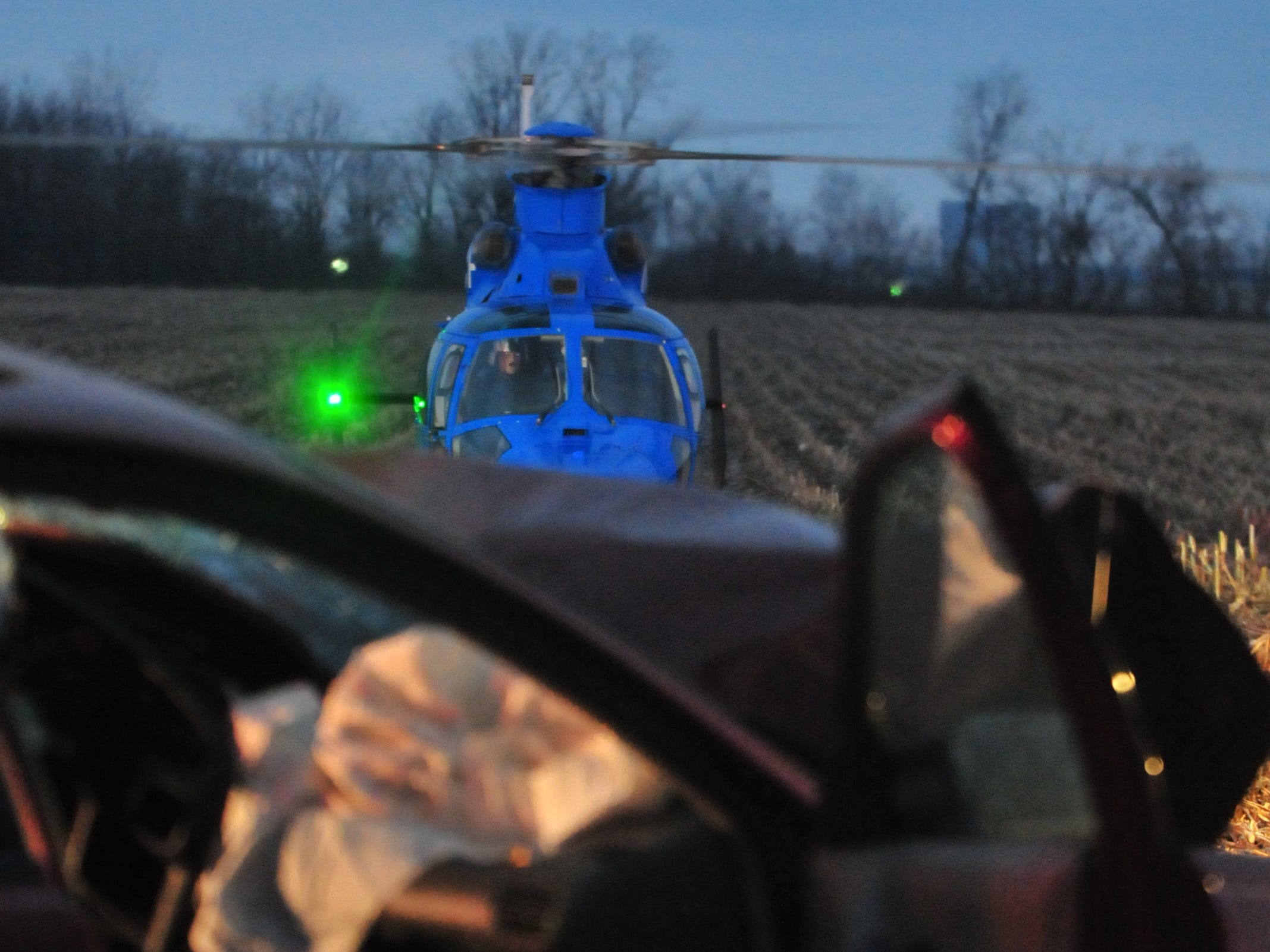 A Careflight helicopter waits for a patient at the scene of a head-on collision on Salisbury Road.