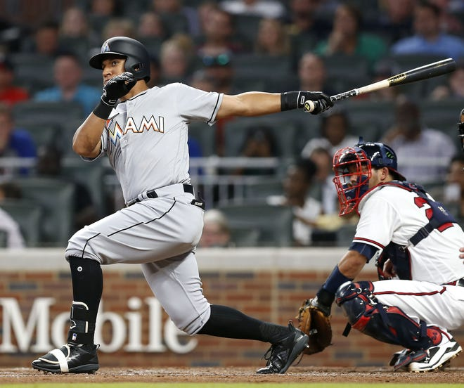 Christopher Bostick of the Miami Marlins hits a pinch-hit RBI double in the sixth inning against the Atlanta Braves on Aug. 14. Bostick signed a minor league contract with the Baltimore Orioles on Wednesday.