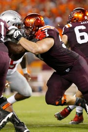 Virginia Tech offensive lineman Wyatt Teller (57) blocks against the Ohio State Buckeyes at Lane Stadium in a 2015 game.