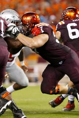 Virginia Tech offensive lineman Wyatt Teller (57) blocks against the Ohio State Buckeyes at Lane Stadium in a 2015 game.