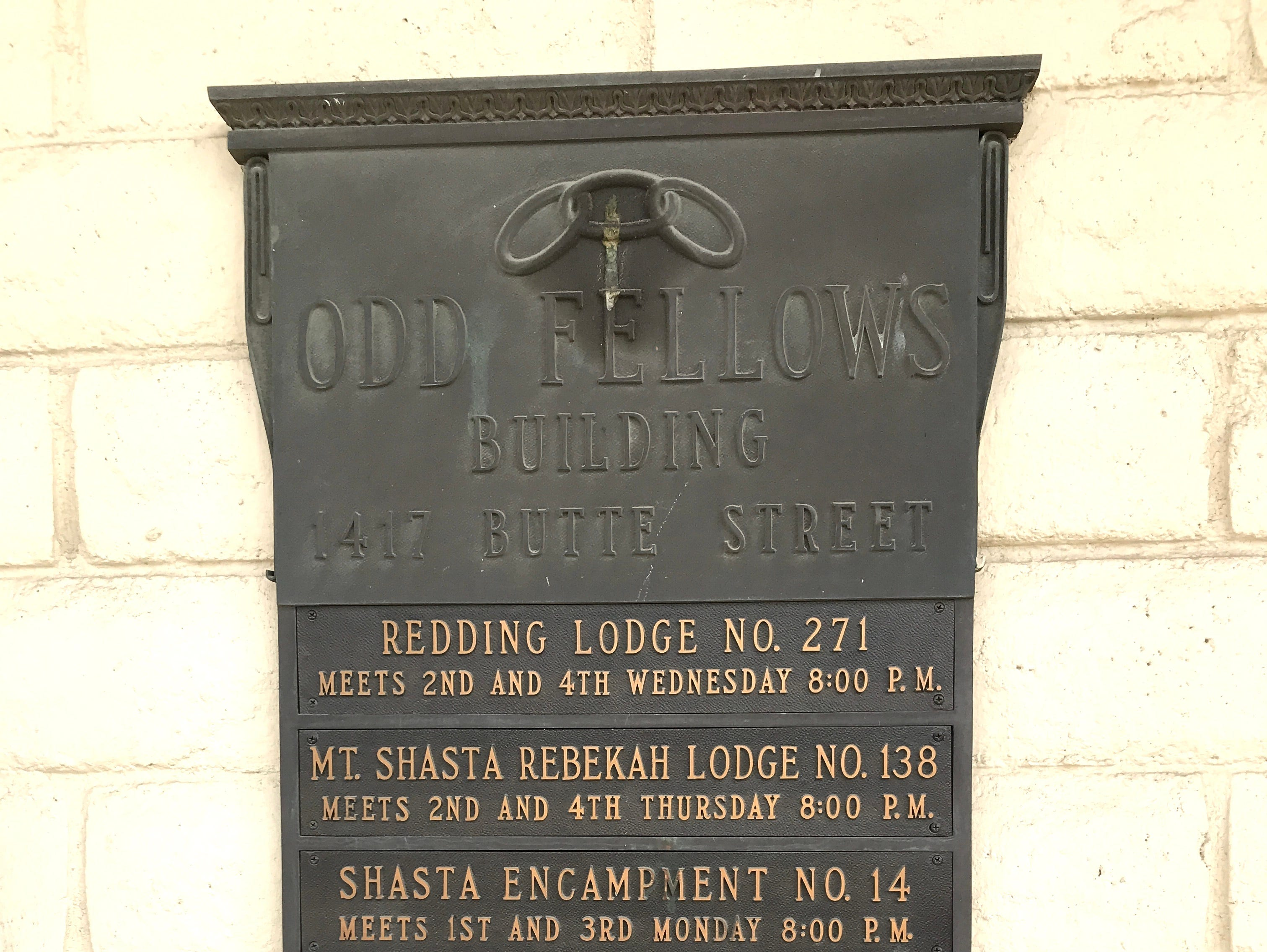 This plaque is affixed to the outside of the IOOF Hall in downtown Redding.