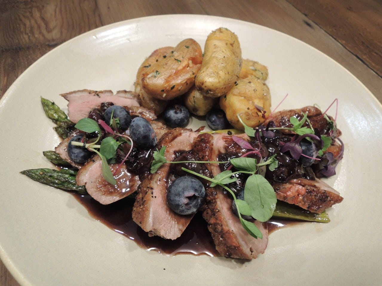 The duck special at the Woodside Grill, a creation of new executive chef Josh Lozoya.