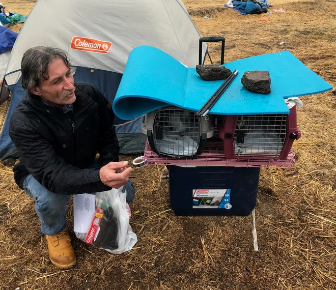 Chris Yarbrough of Upper Magalia escaped from the Camp Fire with his three pigeons and little else.