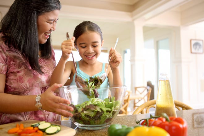 Involving family members in the cooking process may promote healthy eating habits.