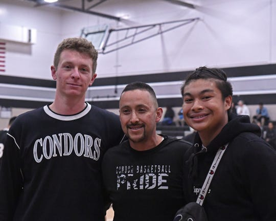 North Monterey County High School faculty Austin Self (left), Jesus Galindo (middle) and Eli Tolentino (right) pose during the Condors' Alumni Game. Self and Galindo were honored during the second game of the night for helping save Tolentino's life.