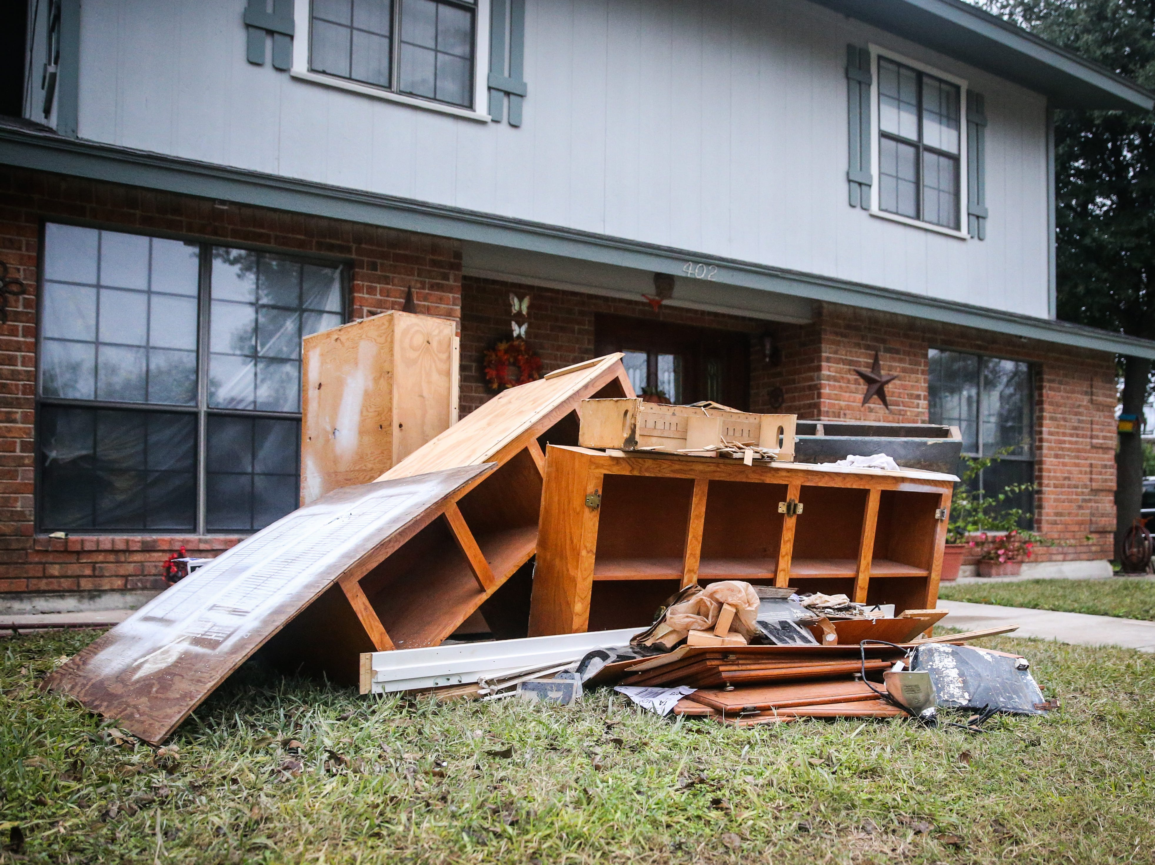 A pile of damaged furniture is set out outside a home Nov. 8, 2018, after the Sept. 21 flood in Sonora.