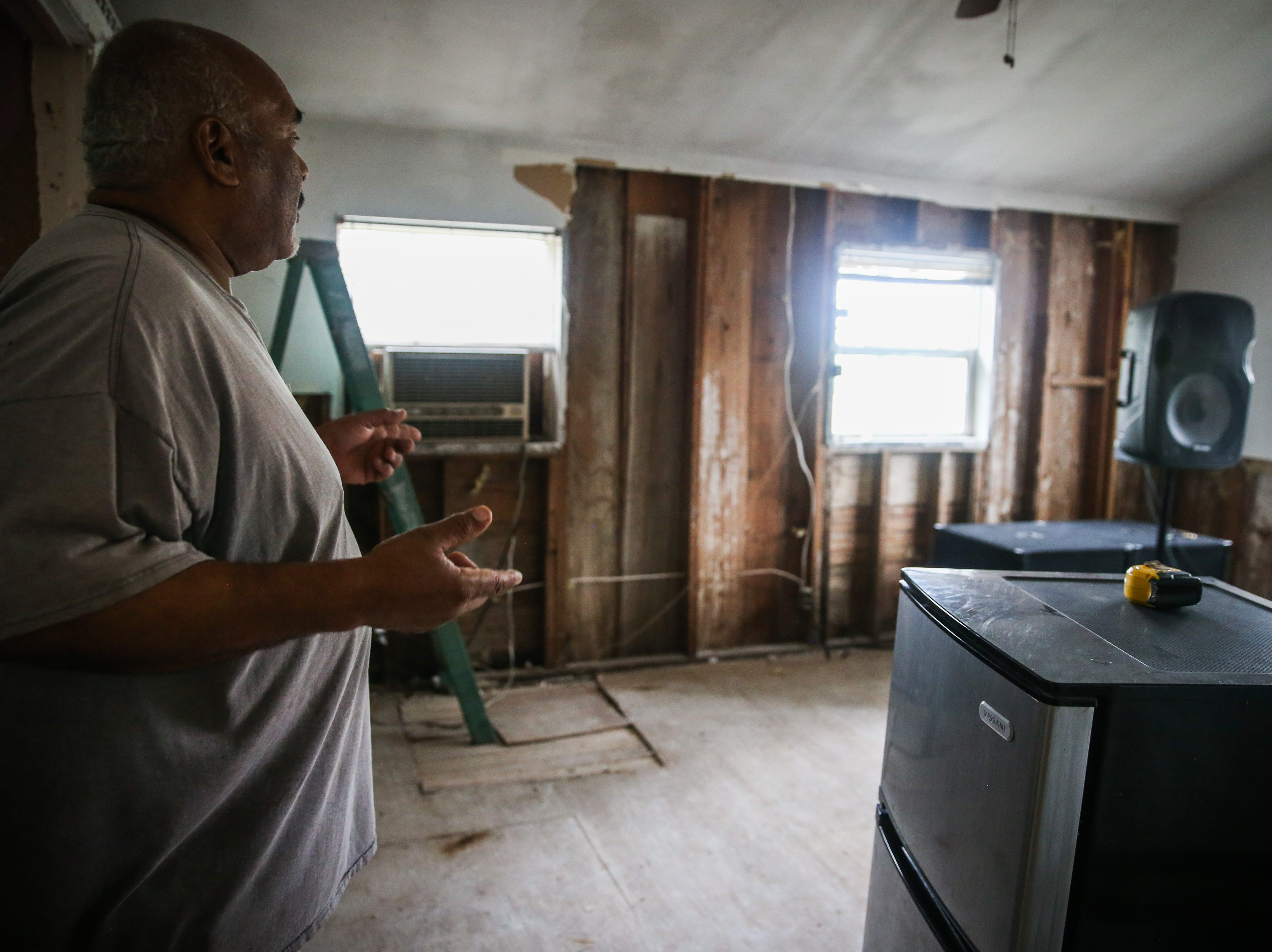 Felip DeHoyos points out flood damage in his home Nov. 8, 2018, after the Sept. 21 flood in Sonora.