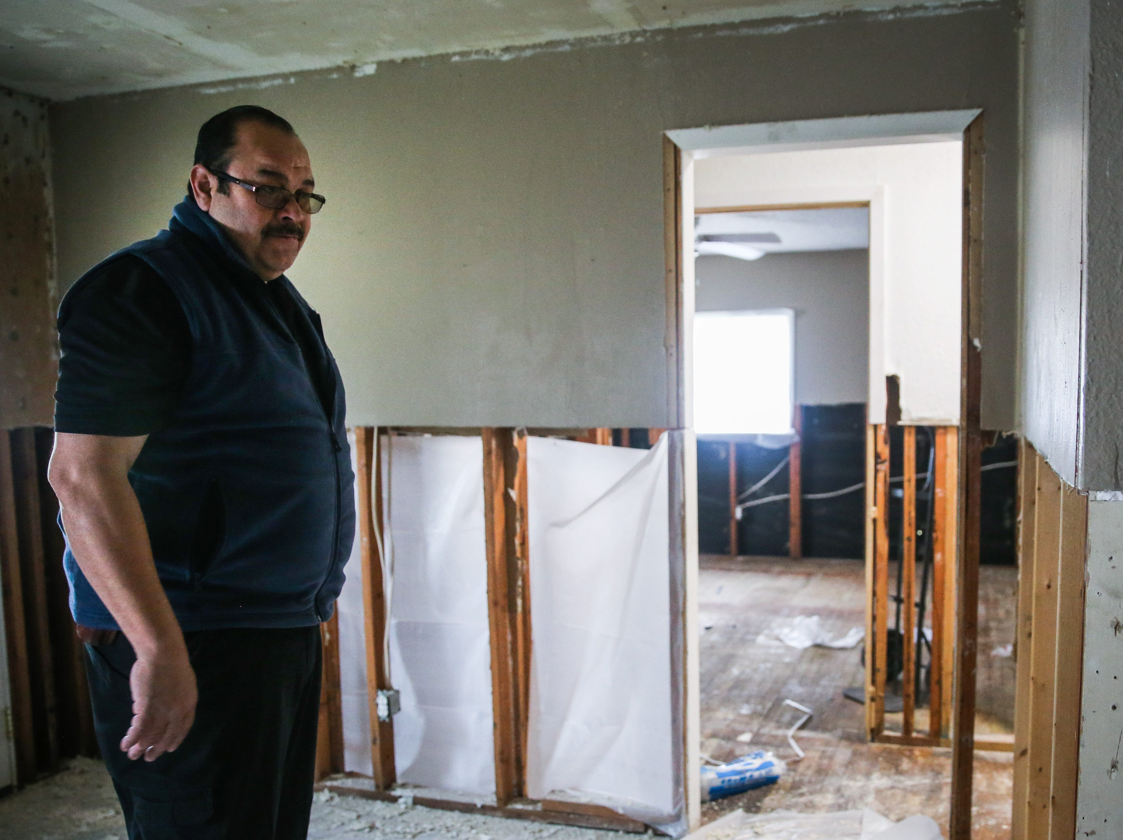 Sonora Police Chief Arturo Fuentes inspects the damage in his home Nov. 8, 2018, after the Sept. 21 flood.