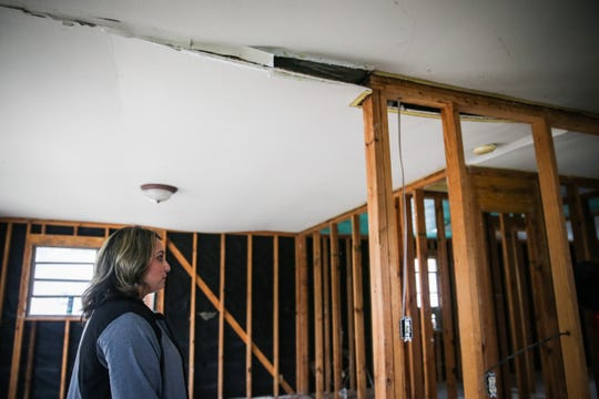 Crystal Villanueva walks through her damaged home Nov. 8, 2018, after the Sept. 21 flood in Sonora.