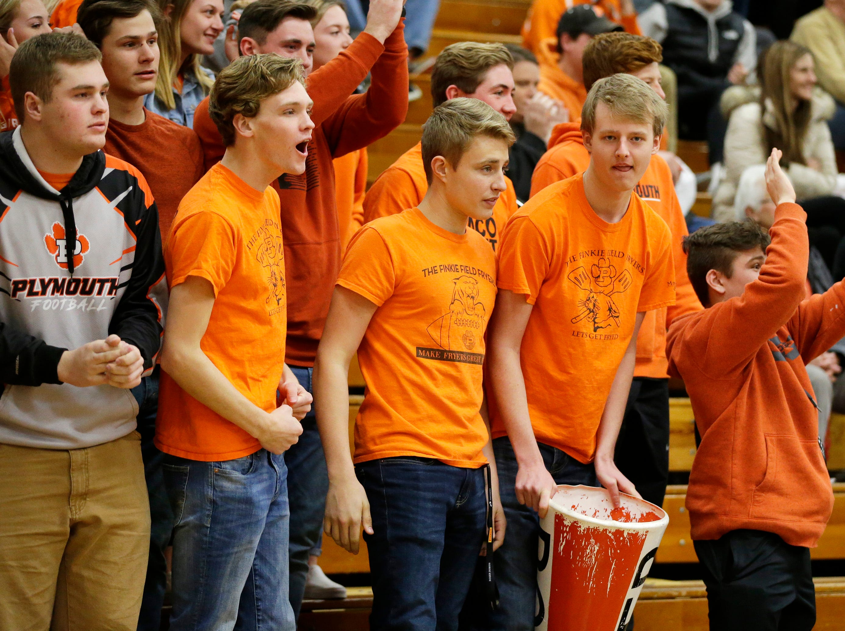 Plymouth fans cheer on the Panthers during action with Sheboygan Falls, Tuesday, November 20, 2018, in Sheboygan Falls, Wis..