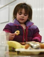 Adilynn Dawson, 2, eats dinner at The Banquet West in Sioux Falls, S.D., Tuesday, Nov. 20, 2018.
