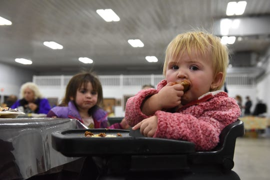 Briella Dawson, 1, eats dinner at The Banquet West in Sioux Falls, S.D., Tuesday, Nov. 20, 2018.