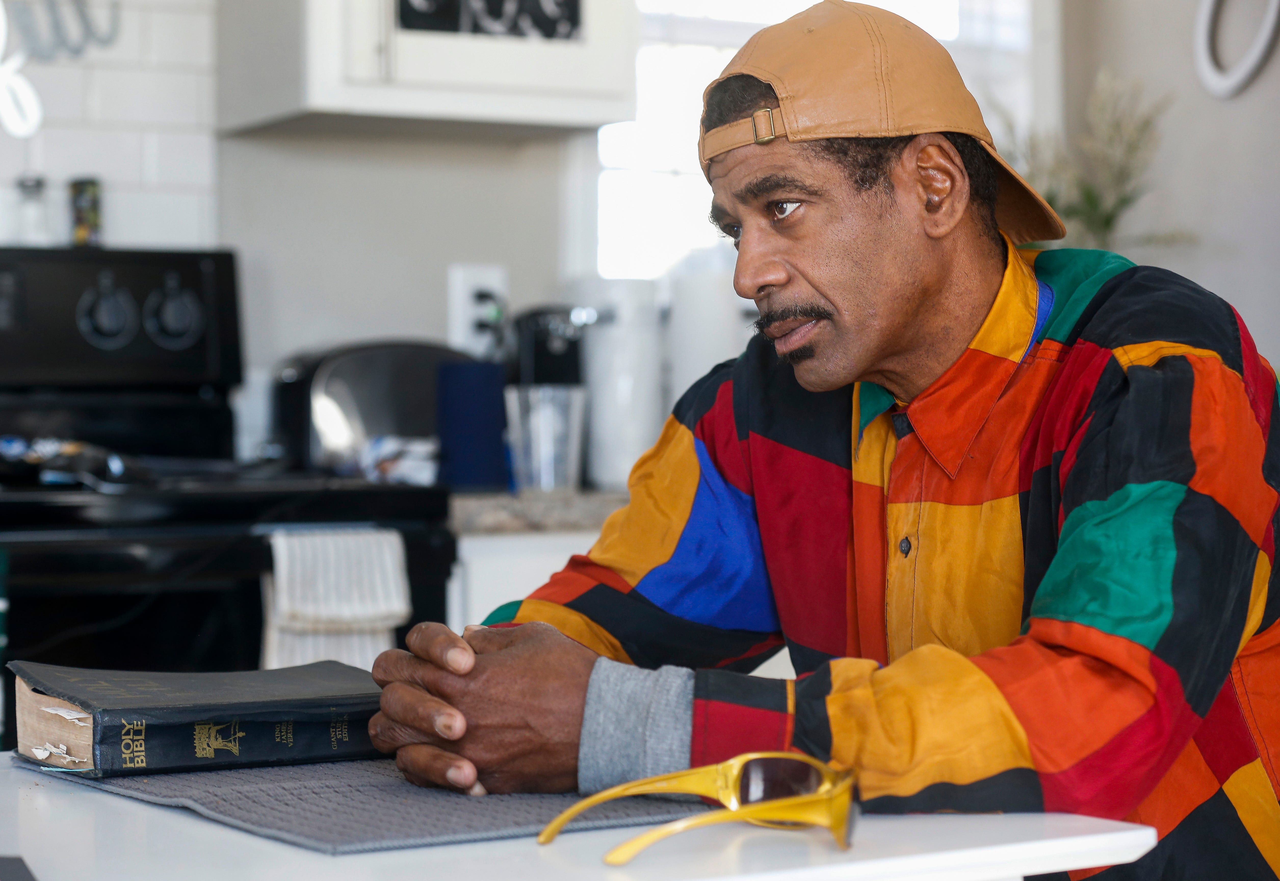 Gary Boots talks about his experiences being homeless while sitting at his new kitchen table inside his tiny house at Eden Village on Tuesday, Nov. 20, 2018.
