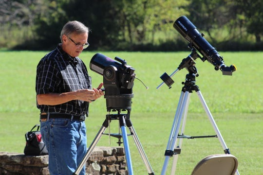 Amateur photographer Allan Staib setting up telescopes for a night viewing session at the Buffalo National River.