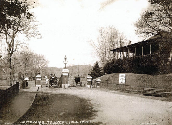 """Early 1900s postcard view of horse-drawn carriages entering Gypsy Hill Park through the main gate on Churchville Avenue. A sign to the right reads, """"Automobiles not allowed in park."""" The ban on autos in Gypsy Hill was lifted in October 1916, but only after regulations were put into place that ensured that """"pedestrians, and especially women and children, would have all the freedom necessary in enjoying the park."""""""