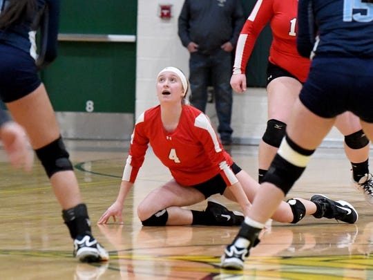 Riverheads' Emma Tomlinson looks up to the ball after diving forward to keep it in the air during the VHSL Class 1 state championship volleyball match played in Roanoke on Tuesday, Nov. 20, 2018.