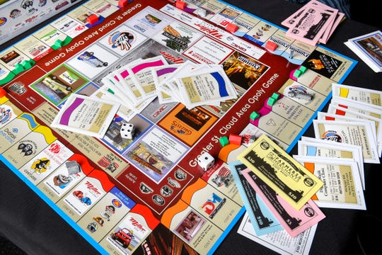 """Tom Dukowitz has created a new board game, """"Greater St. Cloud Area Opoly,"""" shown Wednesday, Nov. 21, in St. Cloud."""