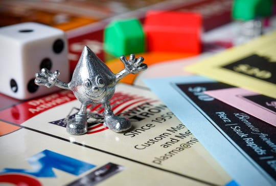 "Tom Dukowitz has created the new board game ""Greater St. Cloud Area Opoly,"" shown Wednesday, Nov. 21, in St. Cloud."