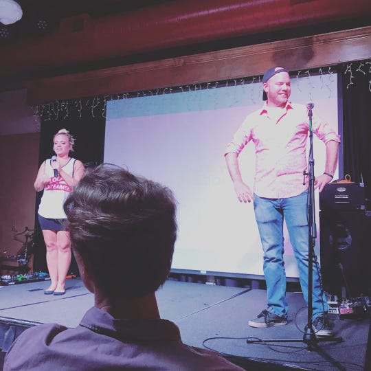 Mary Helgager and TJ Larum on stage during a St. Cloud PechaKucha Night, which they organized.