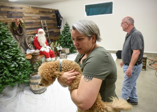 Brooke Strassburg works with a dog during the Tri-County Humane Society's Santa Paws fundraiser Friday, Nov. 16, in St. Cloud.