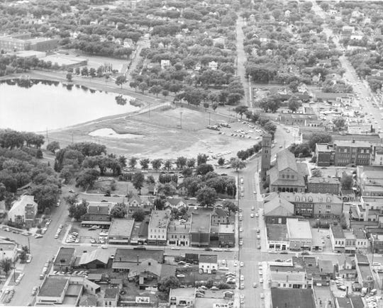 The beginnings of Liberty Bank Minnesota's former downtown site is shown about one block east of where Lake George sprawled across modern-day Minnesota Highway 23. The site includes, shown from left to right on Seventh Avenue, a DeSoto car dealership, a market, Jack Frost Hatchery and Liberty Finance.
