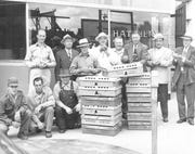 Men stand outside Jack Frost, a chicken hatchery, which opened in the mid-1930s in downtown St. Cloud.