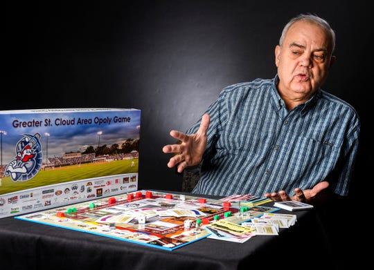 """Tom Dukowitz talks about his new board game """"Greater St. Cloud Area Opoly"""" Wednesday, Nov. 21, in St. Cloud."""