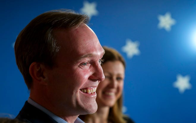 Ben McAdams stands with his family as he speaks at a news conference on Nov. 19, 2018, in Millcreek, Utah.