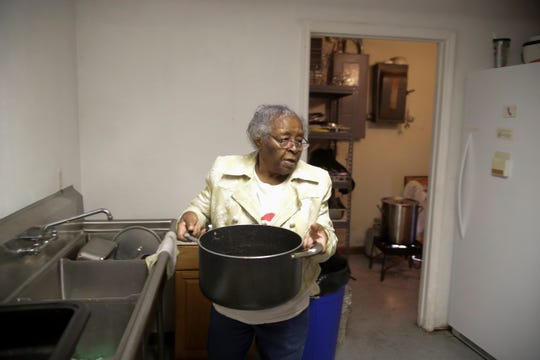 Annie Johnson puts a pot of water on the stove as she prepares food for Project Annie's Thanksgiving dinner which will be served at 625 West Fourth Avenue in Frenchtown on Thursday from 11 a.m. until 3 p.m.