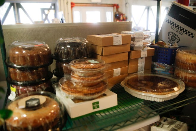 Pies and other donated goods are stacked up as volunteers prepare for Project Annie's Thanksgiving meal Wednesday, Nov. 21, 2018.