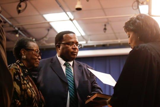 School Board Member Darryl Jones is sworn in during the Leon County School Board reorganization meeting at the Howell Center Tuesday, Nov. 20, 2018.