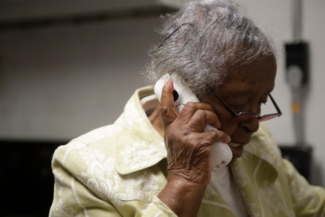 While fielding about seven calls an hour, Annie Johnson multitasks answering the phone and making sweet potato pie in the kitchen as she prepares the Project Annie Thanksgiving meal Wednesday, Nov. 21, 2018, which will be served on Thursday from 11 a.m. until 3 p.m.
