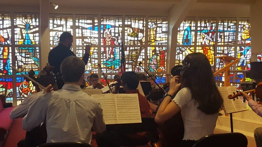 The Youth String Orchestra rehearses for the annual Christmas Cantata at First Presbyterian Church of Vero Beach.