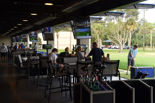 BigShots Golf in Vero Beach offers a two-story driving range experience where patrons can order food and drinks from the full-service restaurant and two bars.