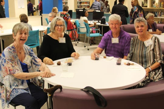 Mary Clair Gildea, left, Ann Middlebrooks with Ed and Bonnie Bohannon enjoying drinks and hors devours provided by Catering Revolution inside the Lewis Library.
