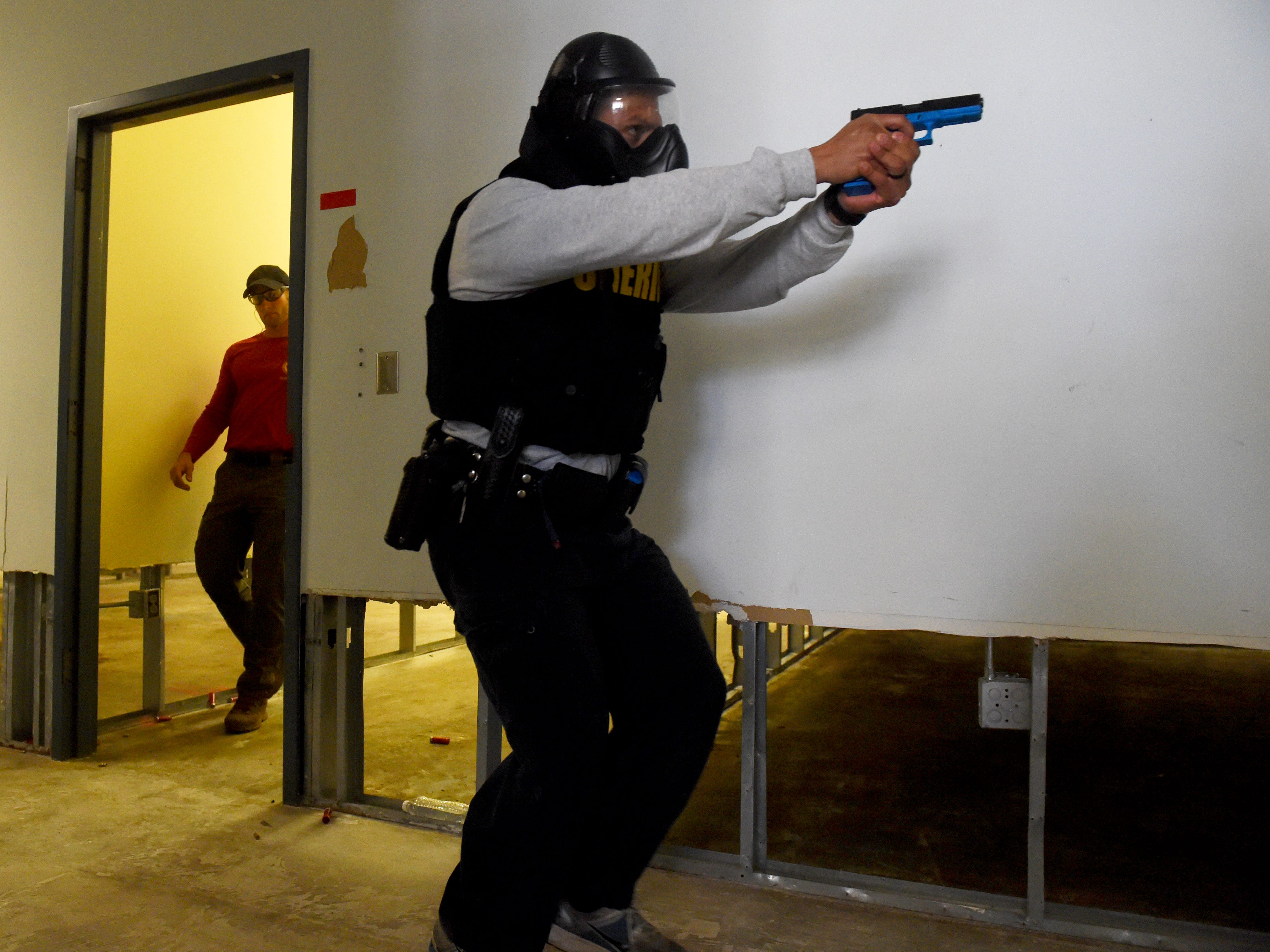 """A St. Lucie County Sheriff school resource deputy makes his way down the hallway of the Orange Blossom Business Center on Monday, March 19, 2018 during an active shooter training exercise in Fort Pierce. """"I'm committed to this, the command members are committed this, our training members are committed to this, that our first responders know how to react and respond to an active shooter,"""" said St. Lucie County Sheriff Ken Mascara. """"We're putting the training together so that it's a reflex, they don't even have to think about it. They know that when they hear the gunshots that their mission is to direct themselves toward the shooting, identify the shooter and neutralize the shooter."""" Twenty-three school resource deputies participated in the training along with students from Fort Pierce Central High School's Community Emergency Response Team."""